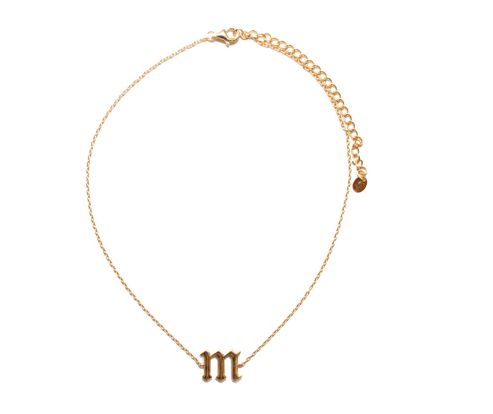 This gothic initial choker is great piece to layer in and looks like a classic piece to add to your layering collection  Gothic Choker / Argento Vivo / $48