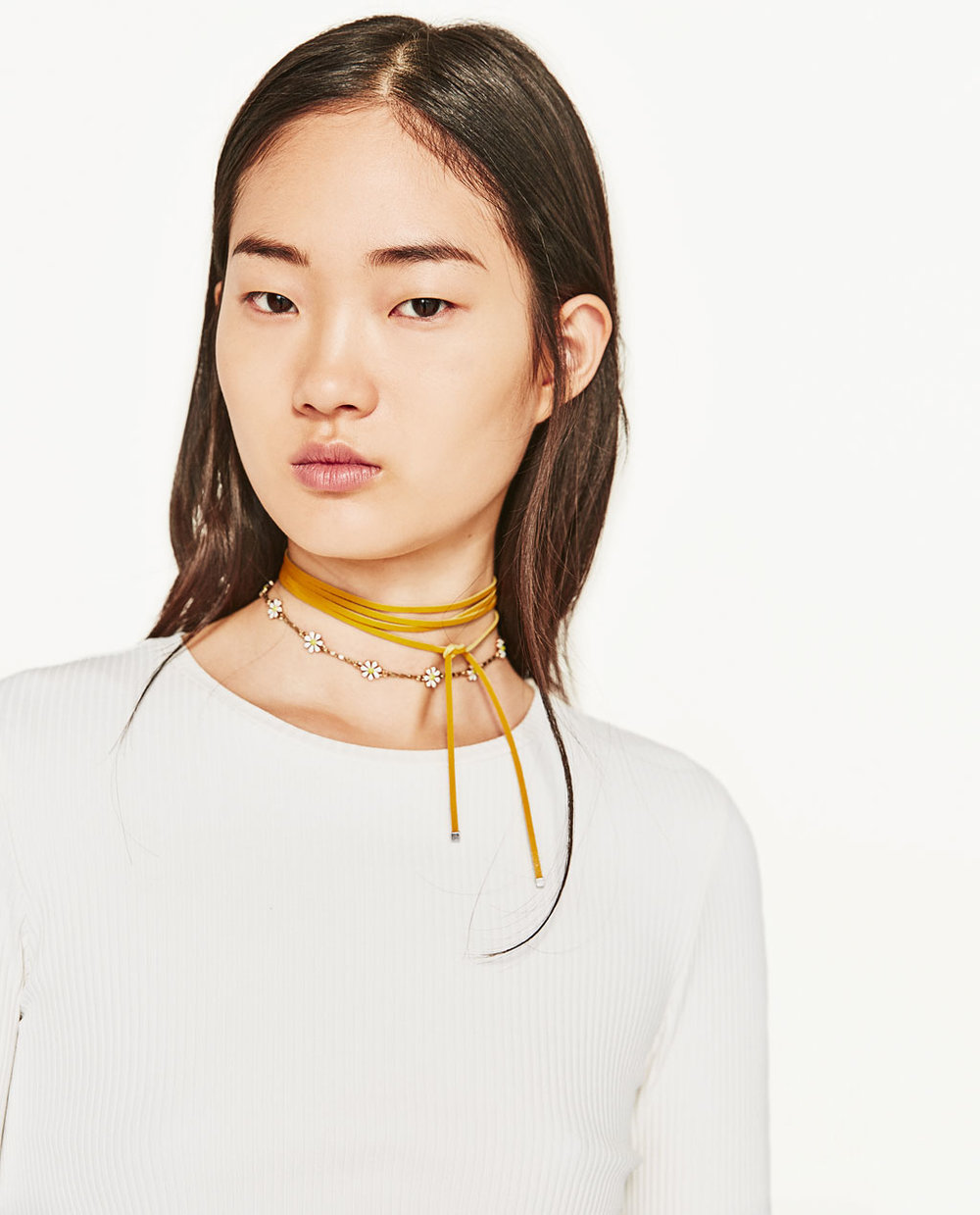 Easy layering set and I love the pop of yellow   3 Pack of Daisy Necklaces  / Zara / $20