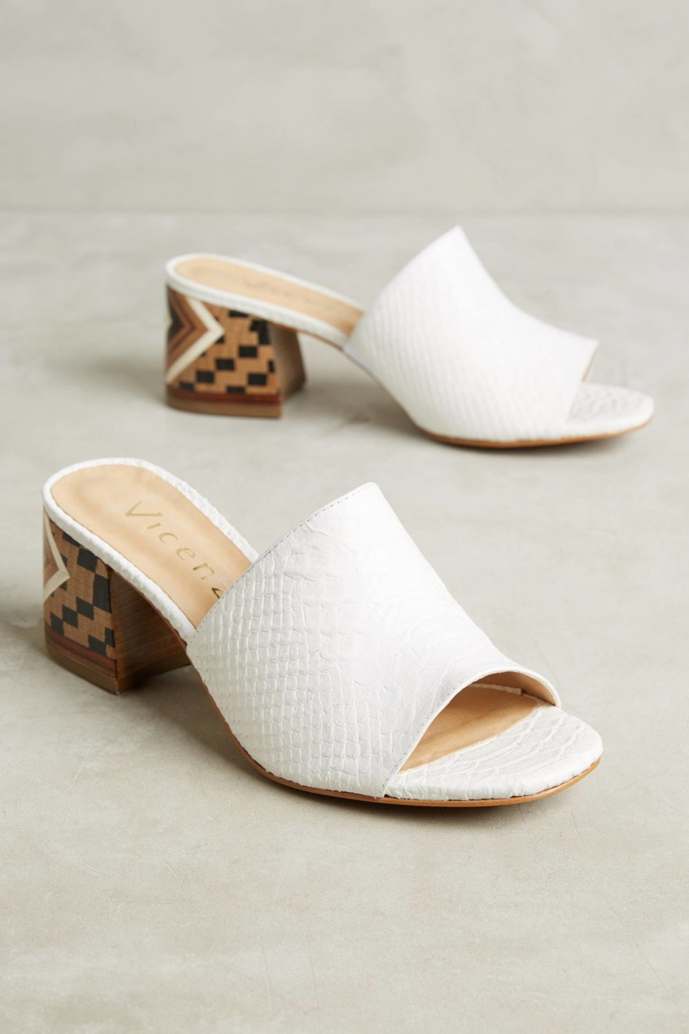 Vicenza Embossed Leather Mule Sandals / Anthropologie / $138  The detail on the heels paired with the white are hot as hell