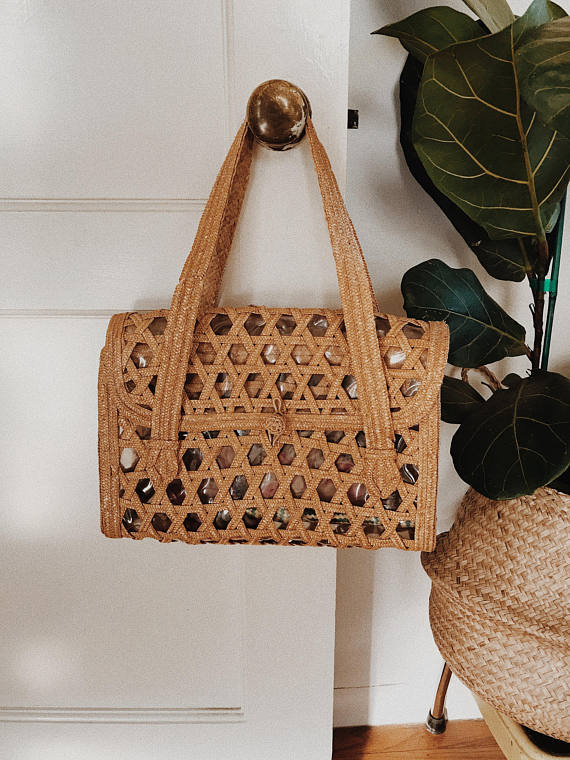 Straw bags are so romantic and necessary - I already have one but hello there... Vintage Straw Bag / Etsy / $30