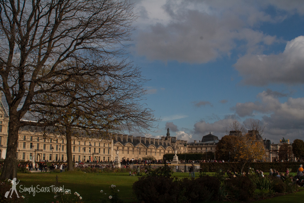 Autumn in Le Jardin des Tuileries with the Louvre museum in the background