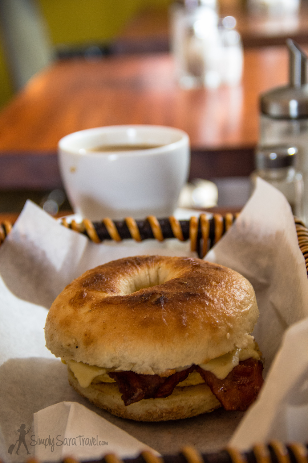 Meet the best breakfast sandwich in Europe to-date: bacon, egg, and Gouda cheese on a toasted bagel. Oh, and that's a mug of filtered coffee in the back. Photo taken before the free coffee refill. Did I mention I love this place?