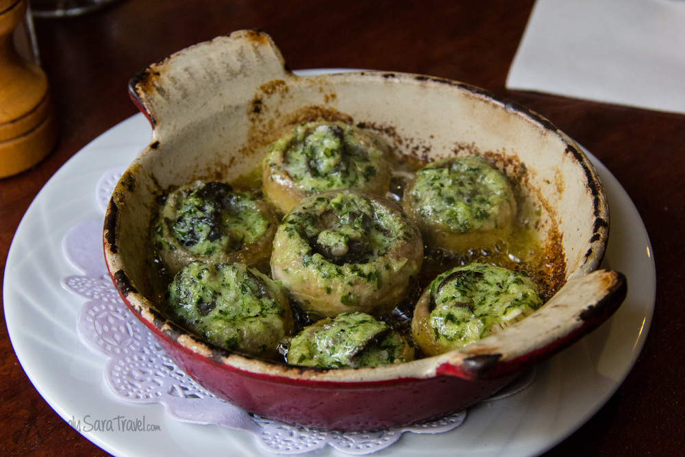 The best way I've ever eaten escargot, served in mushrooms and covered in a garlic and parsley sauce.