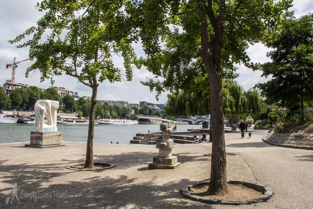 Sculptures and Seine at Jardin Tino-Rossi, Paris