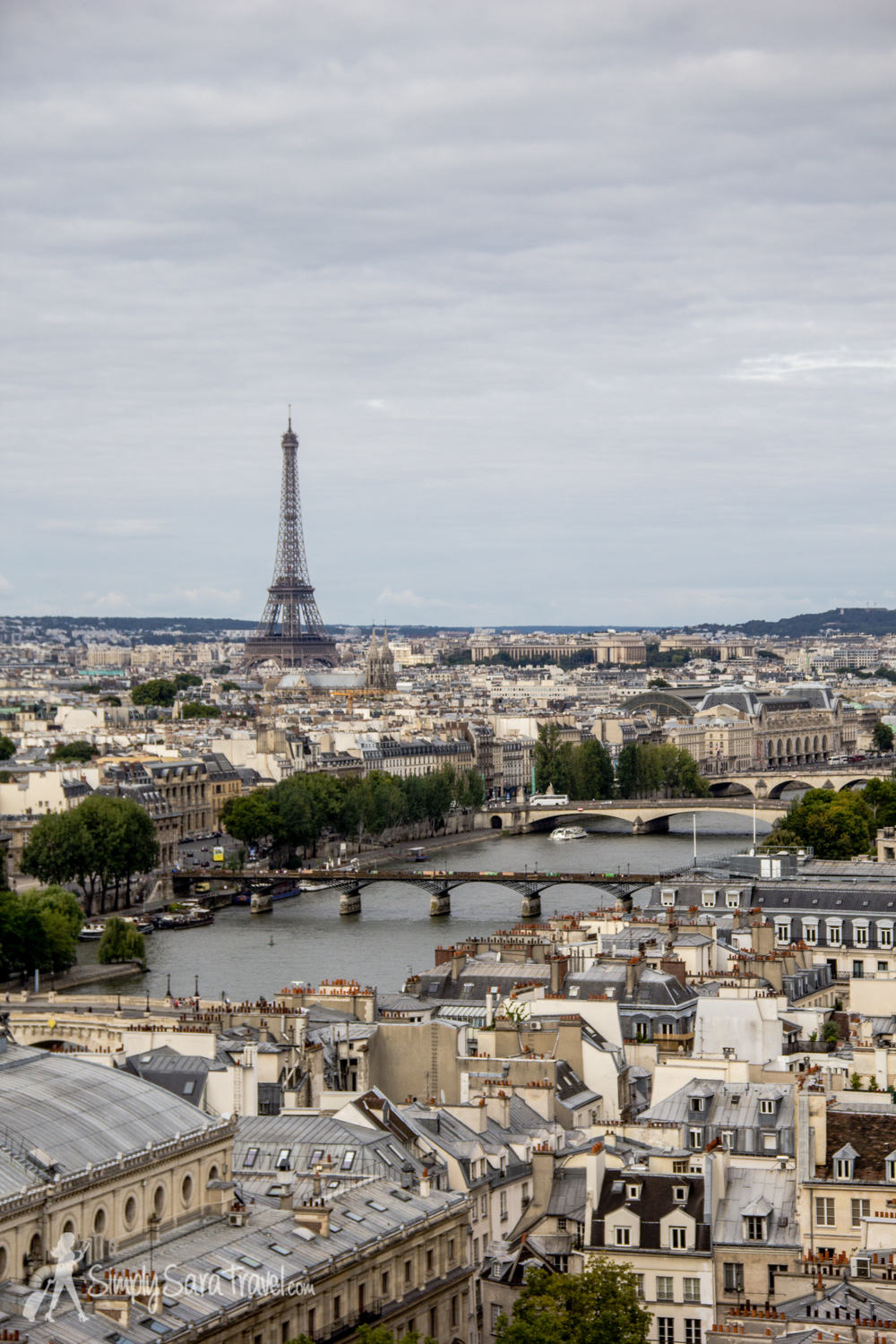 Amid those gorgeous Parisian rooftops stands the Eiffel Tower and Trocadéro to its right