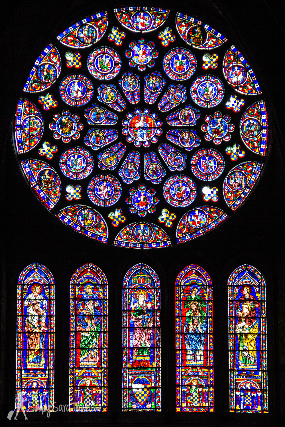 The South Rose Window, dating from about 1225. Check out the bottom row - on either side of Mary holding the infant Jesus are four Old Testament prophets giving piggy-back rides to the four New Testament evangelists.