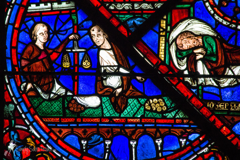 "I got some insight on how to ""read"" Chartres Cathedral's stained glass windows on Malcolm's tour. One thing I learned is to look to see which group sponsored the windows. The various merchant groups donated money to help with the construction of the new cathedral, like this window brought to us by the money changers. Nothing like a little medieval advertisement!"