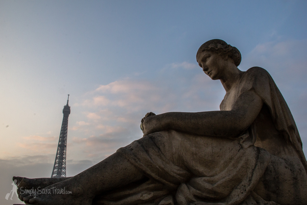 Statue with the Eiffel Tower in background