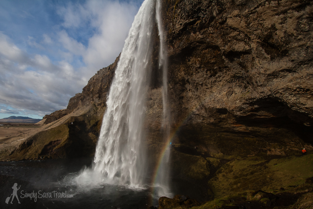 Seljalandsfoss, blue skies, and a misty rainbow dazzled me on my first day in Iceland
