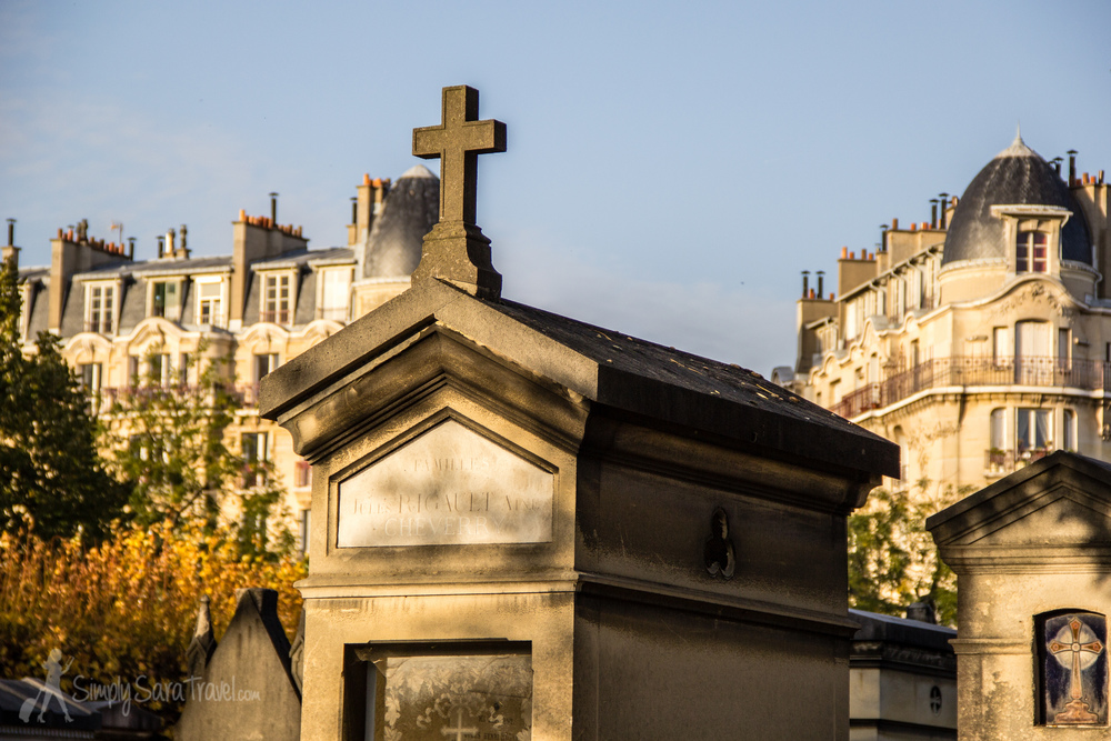 Tomb stones and Paris at Cimetière du Montparnasse