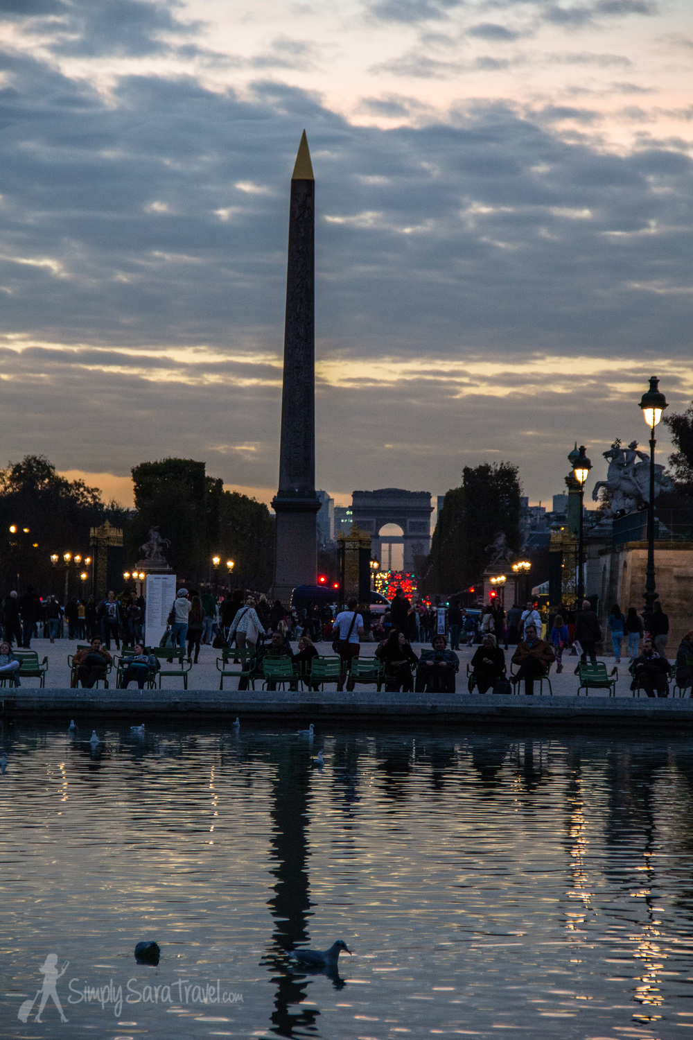 Evening settles in at Jardin des Tuileries with Arc de Triomphe in the background