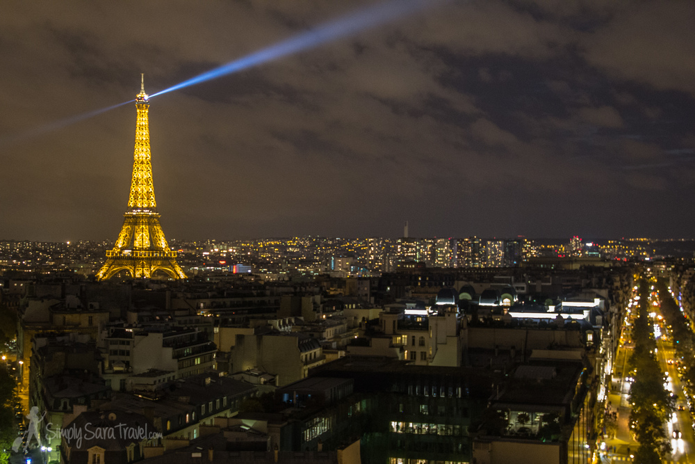 An evening view of the Eiffel Tower from the Arc de Triomphe