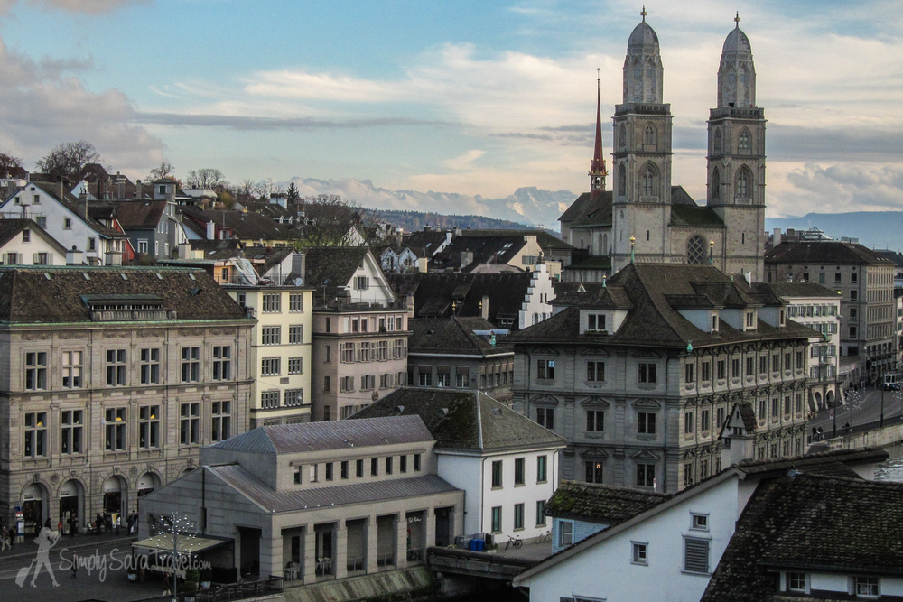 The Grossmünster church with mountains in the background