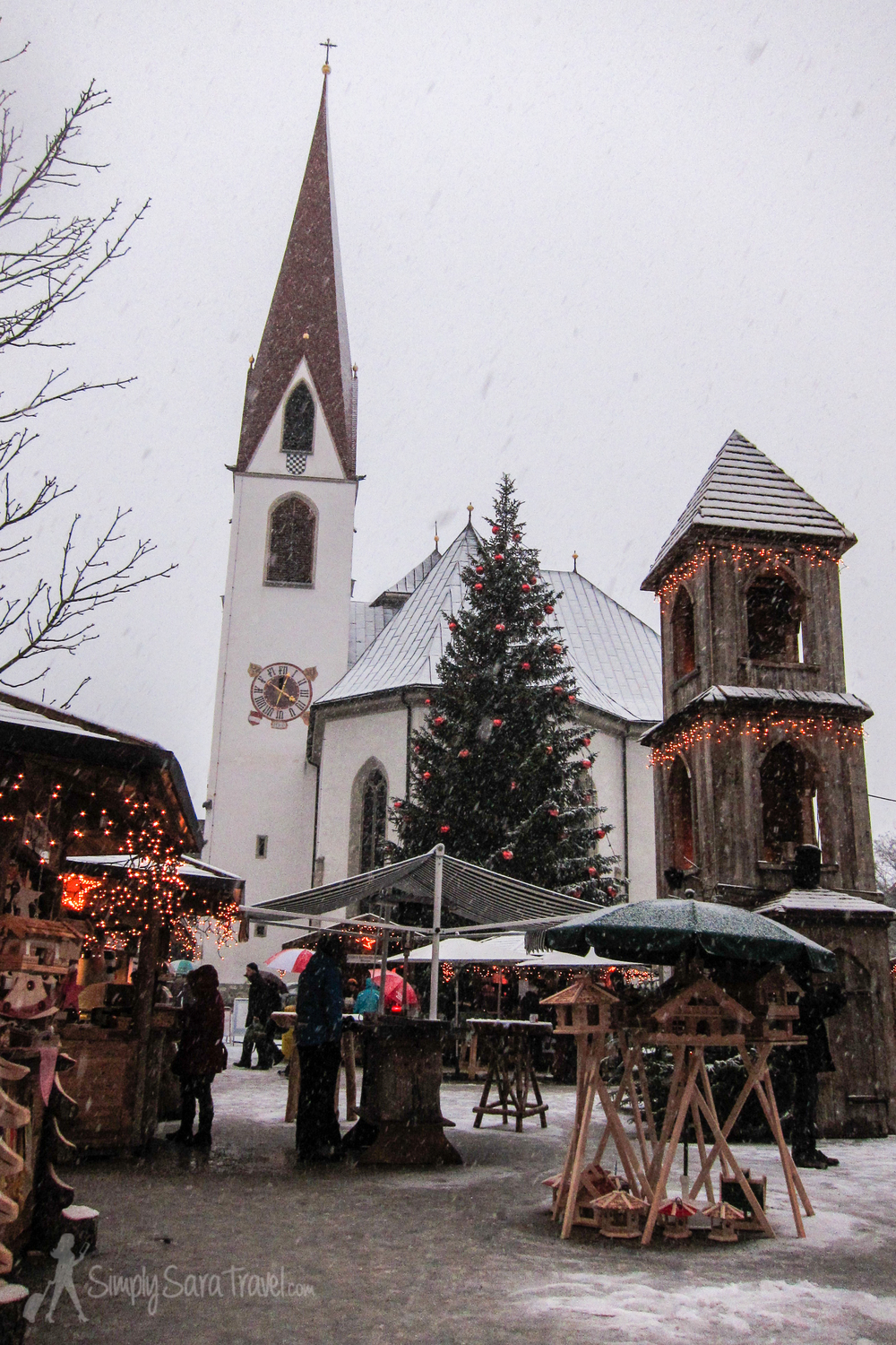 The Christmas market in Seefeld with St. Oswald's church in the background