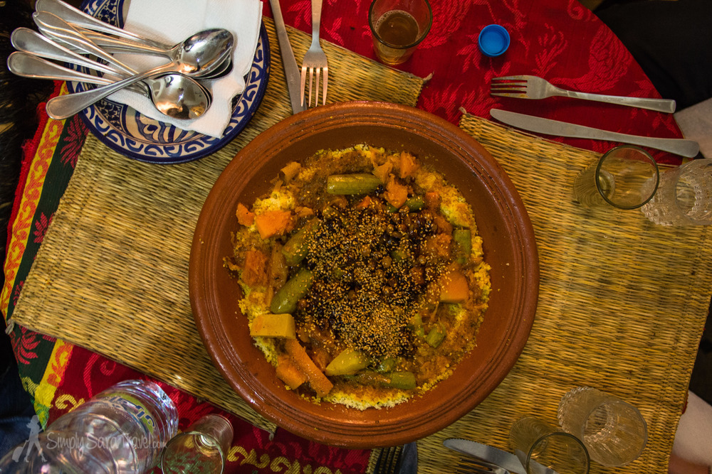 Moroccan couscous at its best - etiquette is to section off a triangle and stick to your bounds as you share with the rest of your party!
