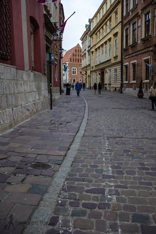 Walking downKanonicza street in Krakow