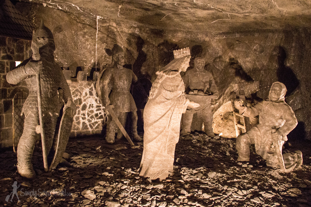 These statues depict the legend of St. Kinga. This Hungarian princess married a Polish king and is credited with bringing salt to Poland. The story goes that she threw her engagement ring in Hungary's Maramures salt mine (while other accounts say that she simply lost it). After the wedding, she ordered the digging of a well at Wieliczka. Low and behold, a miner uncovered her ring (the moment depicted above) which had been carried to Poland by salt deposits.