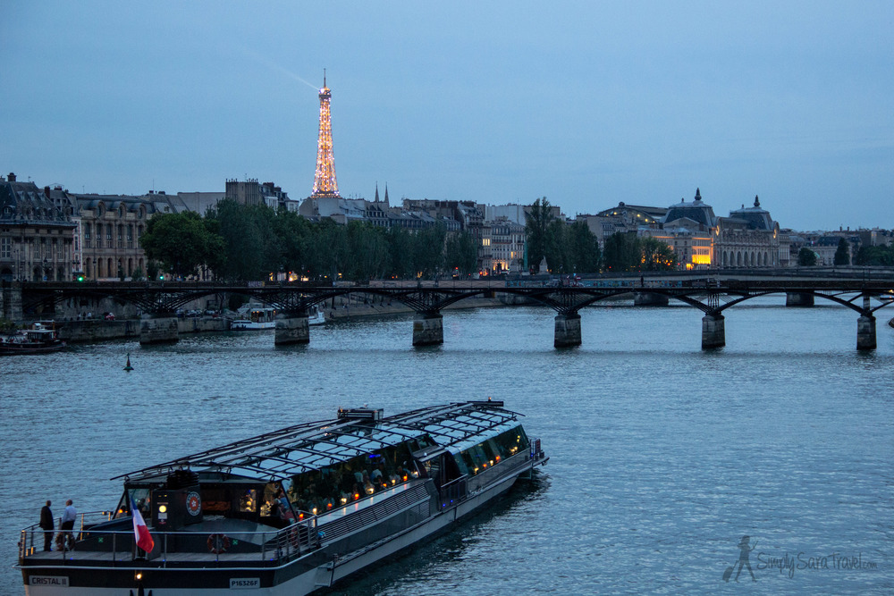 Eiffel Tower sparkling with the Seine and boat in Paris, France