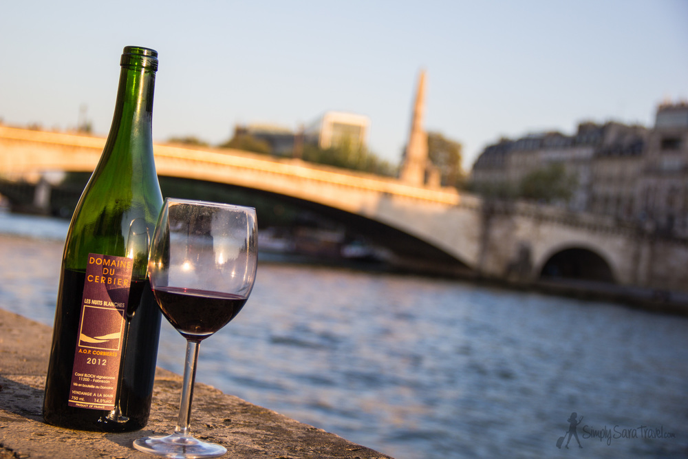Wine at a restaurant can be pricey, but bringing your own means you can have a fantastic bottle at a much lower price. Featured here is one of our favorite wines ever, a lovely Languedoc red from Domaine du Cerbier, sitting pretty along the Seine,