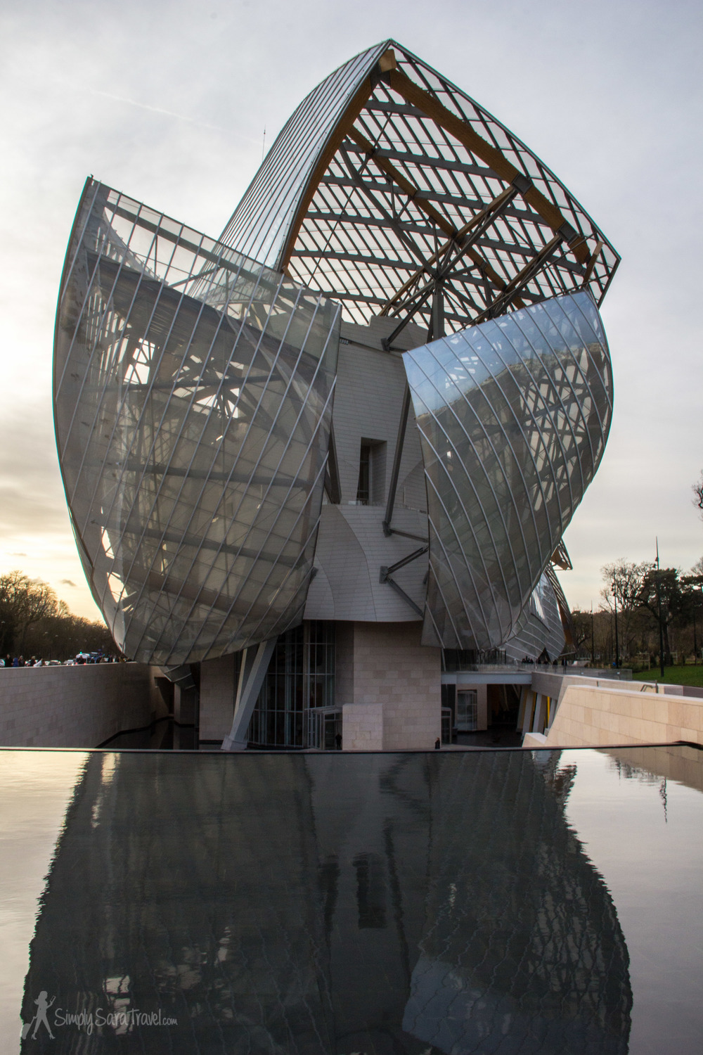 Front view of Fondation Louis Vuitton with fountain in Paris, France