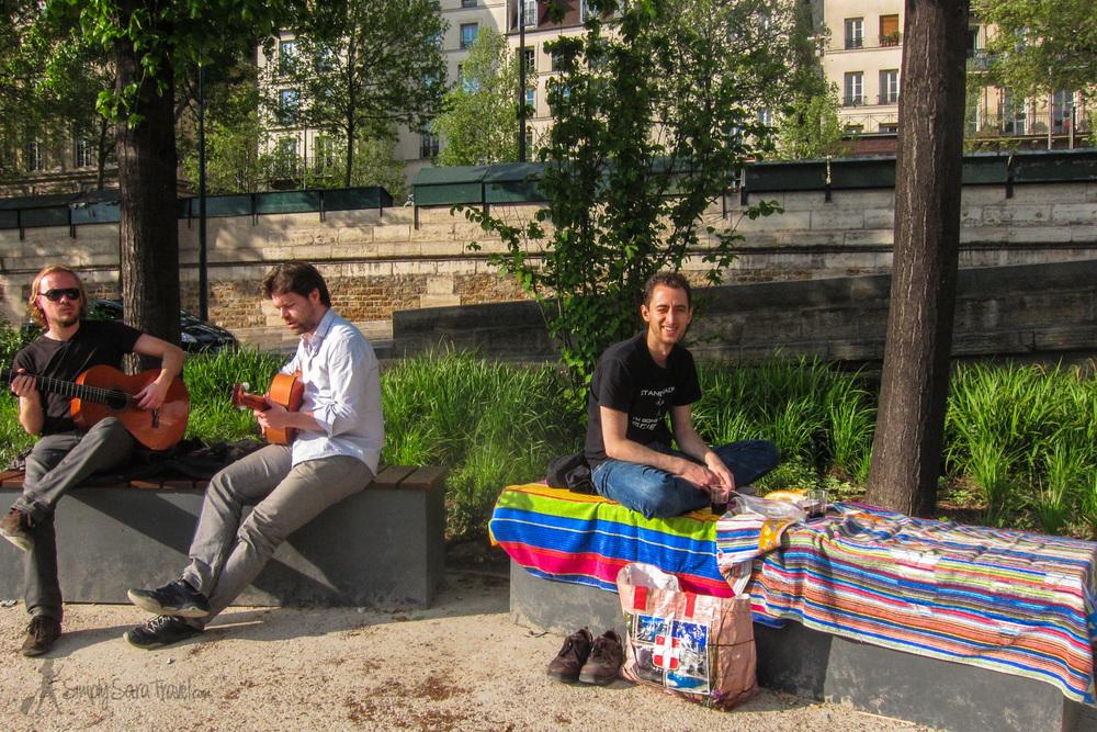 Here's Michael on a bench at ourHôtel de Ville spot, enjoying the music!