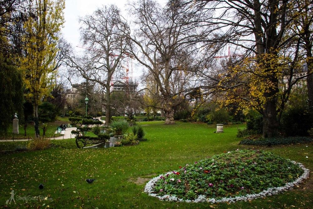 Green lawn of Square des Batignolles, Paris, France in winter