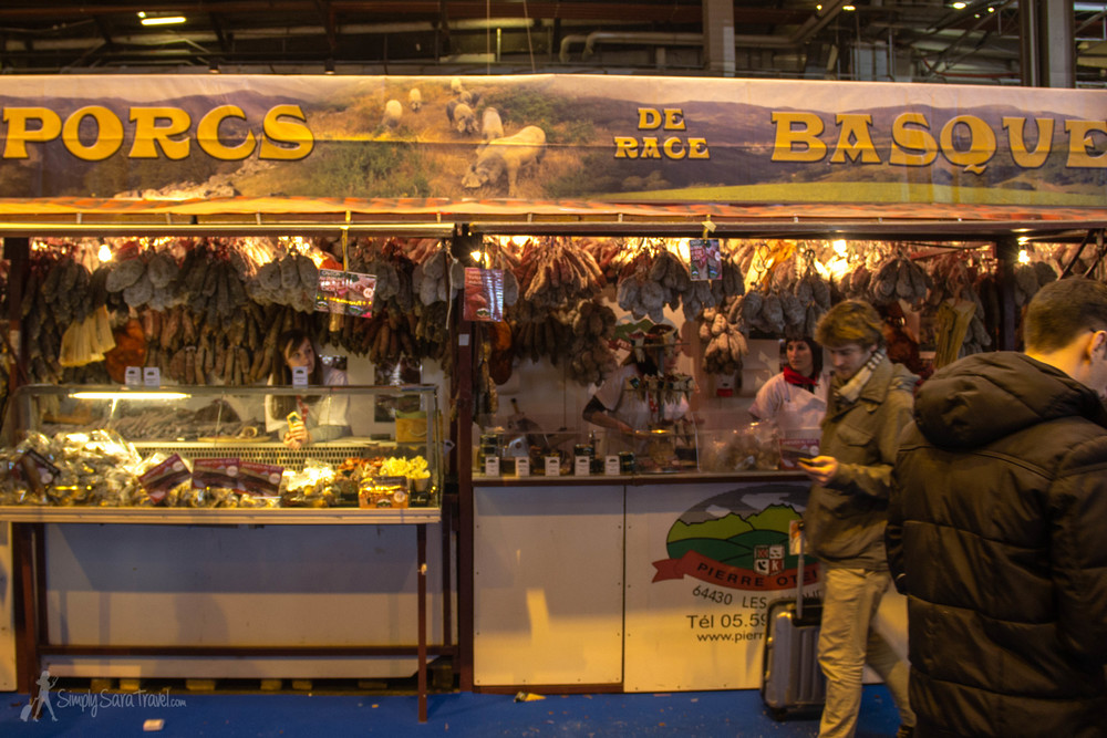 "One of those ""only in France"" moments, when you walk by stalls displaying pigs from all over the country to find a pork stand at the end of the aisle. The French certainly have a realistic and honest approach when it comes to food and its origins..."