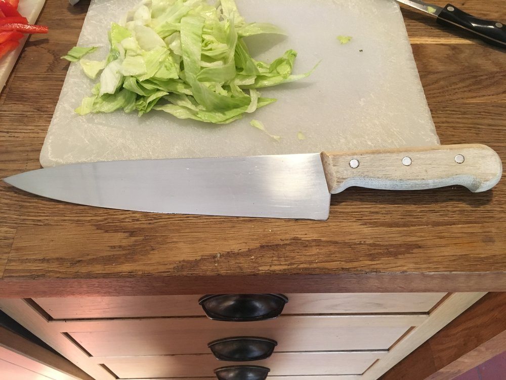 My Sabatier Cook's Knife. Bought in 1989 at Peter Jones. if she ever legs it, the Cook's Knife stays; (hopefully not embedded in my abdomen).