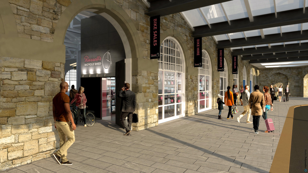 Plans change so fast... the bike shops main entrance will now be at the front of Sheffield Station.