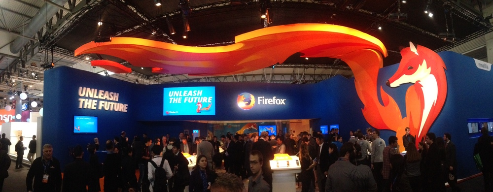 The Firefox OS exhibit at the Mobile World Congress 2014, Barcelona, Spain. (in this photo I can see six screens that are playing the fox animations!)