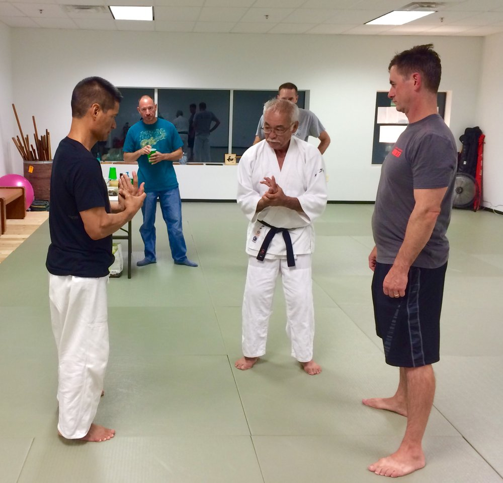 Takeguchi Sensei discussing finer points of Kotegaeshi with Kyle Chock and Tom Boggs.  Greg Hilgenberg and Keith Burmaster in background.