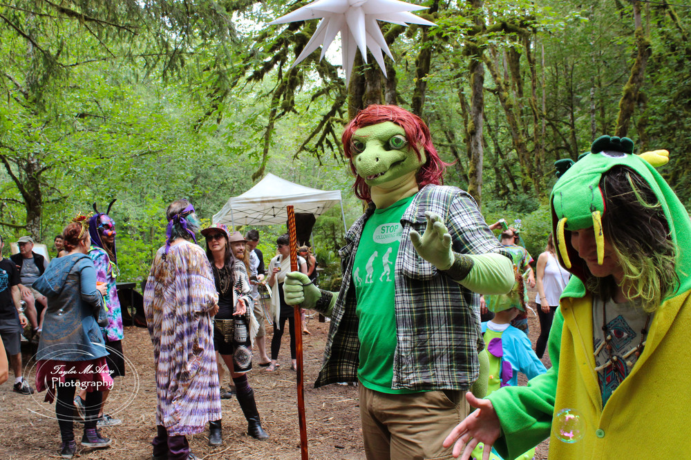 CascadiaNow! communications officer Tanner Colvin sported his lizard man attire, spotted here during the dance party at the end of the Mythica Village parade.