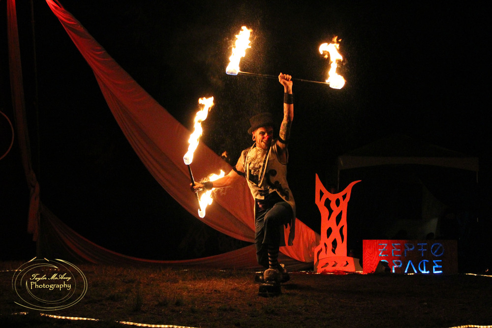 Clown and fire dancer Jpeace Lovecircus delights audiences with his witty fire set.