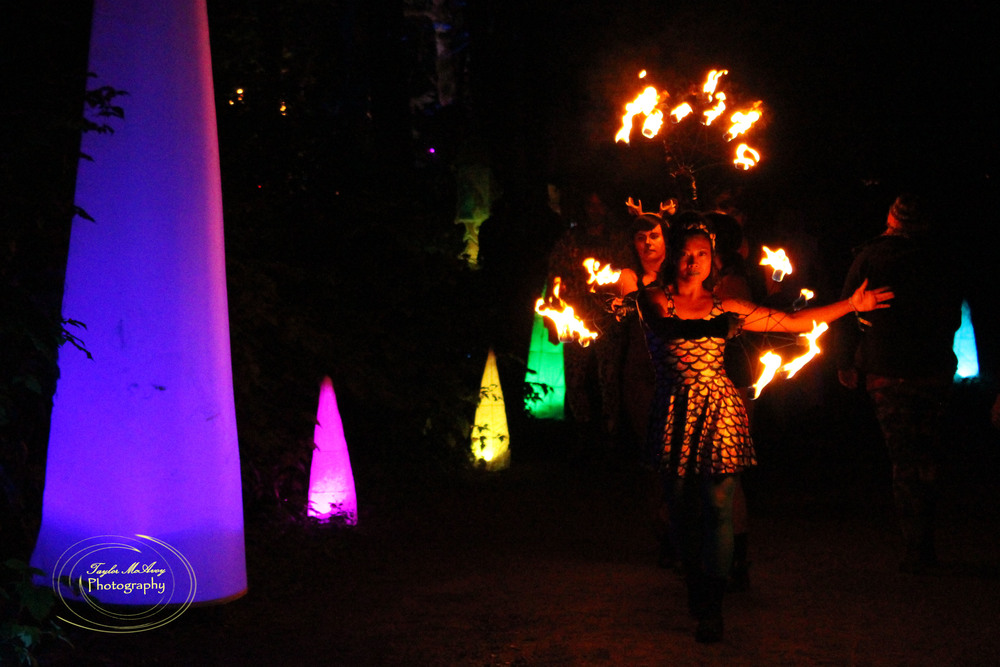 Saleurn Ramos leads her troupe of fire dancers lighting the path to the River stage for their first performance.