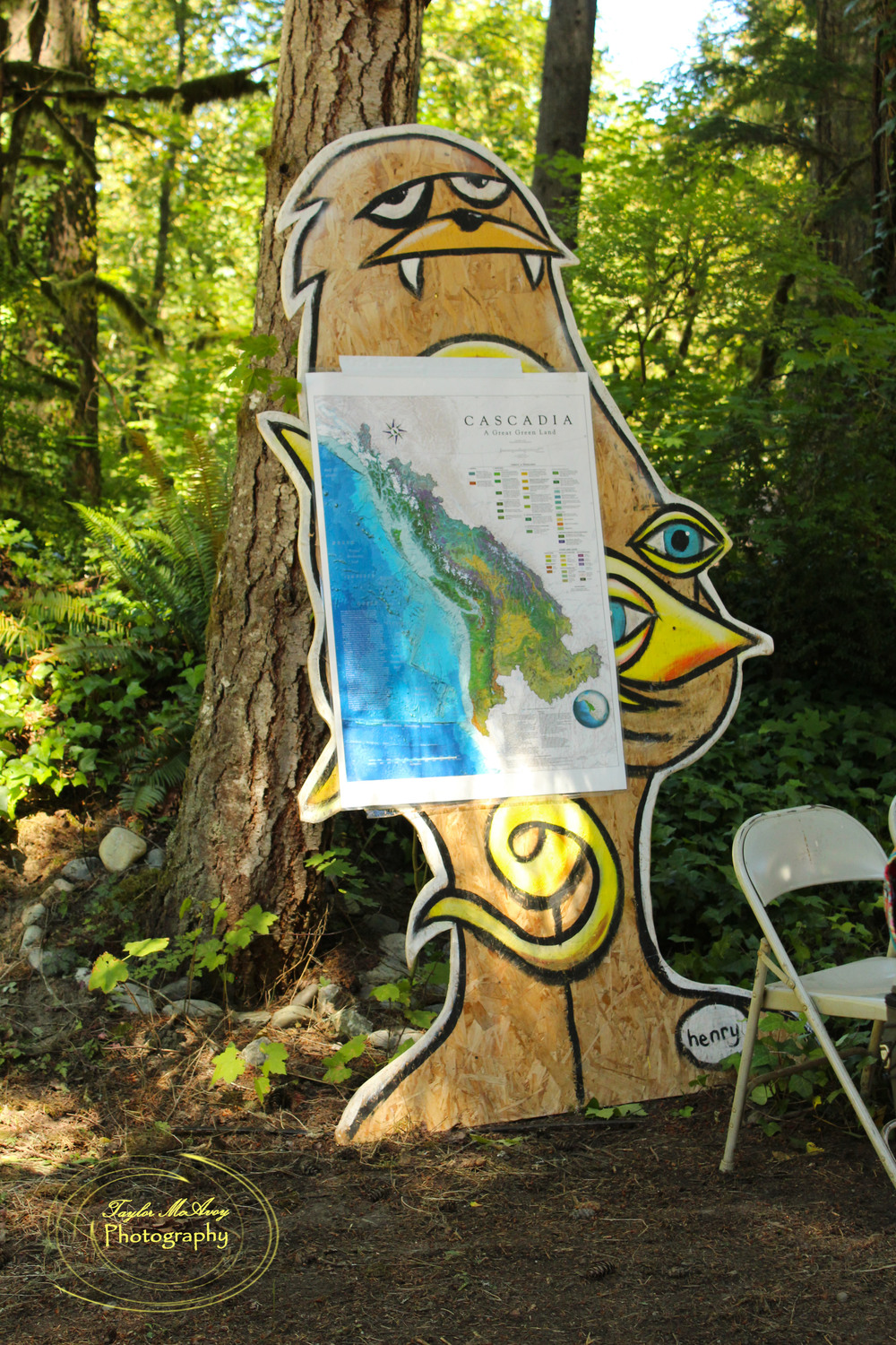 Our resident Sasquatch was one of the few surrounding camp, seen here holding the map of the Cascadia bio-region for Brandon Letsinger's workshop. The Sasquatch and octopus was painted by Seattle artist Ryan Henry Ward.