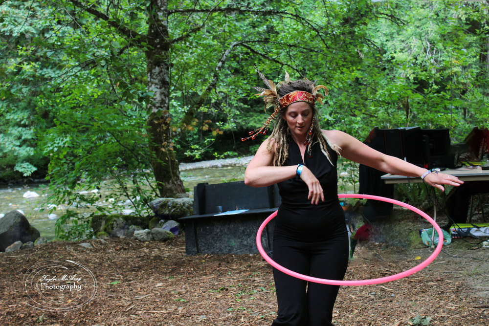 Levi Joy Aley practices hoop dancing by the river.