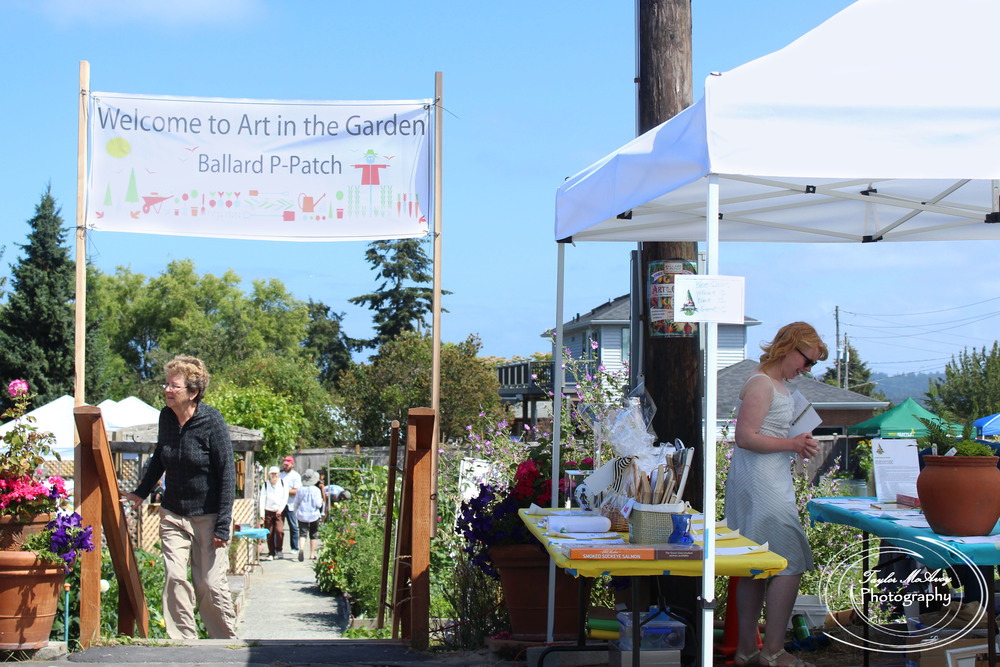 The Ballard P-Patch is a volunteer run garden promoting community and an eco-friendly environment where everyone is welcome. Every year Ballard P-Patch hosts local artists, vendors, musicians, community members, and volunteers in the Art in the Garden event.