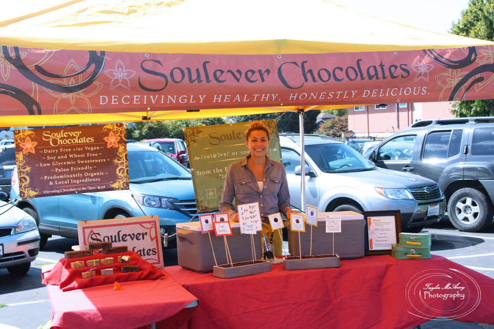 Creator of Soulever Chocolates, Aimee Morrow waits at her booth to hand out chocolate samples. This is Aimee's first year setting up at the P-Patch.