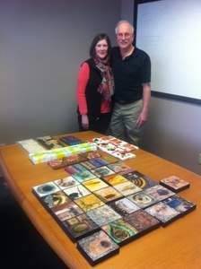 Jeff and Victoria Galbraith with their completed paintings.