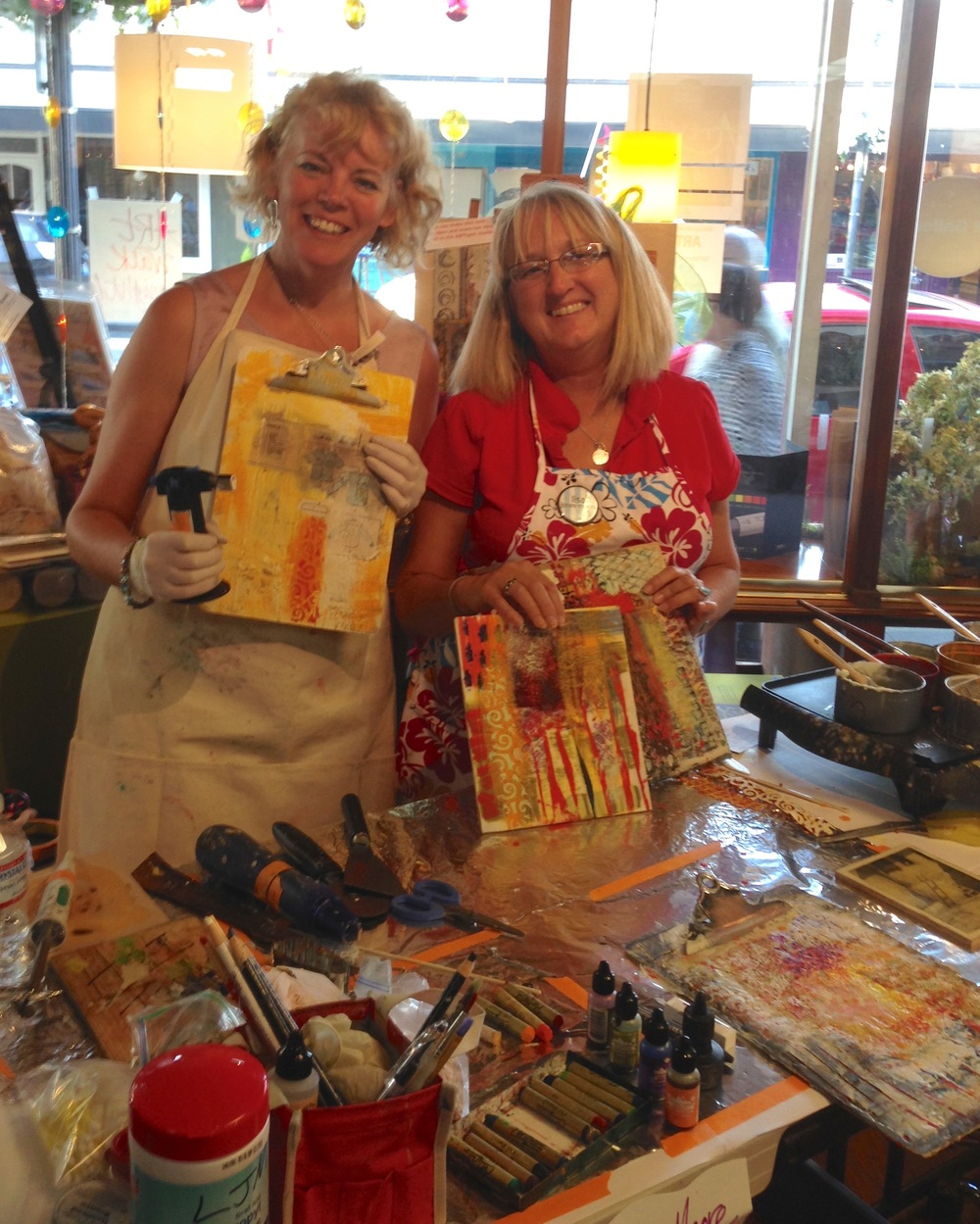 Tracy Felix and Lisa JonesMoore demonstrating encaustic painting during Art Walk Edmonds, held the 3rd Thursday of each month.