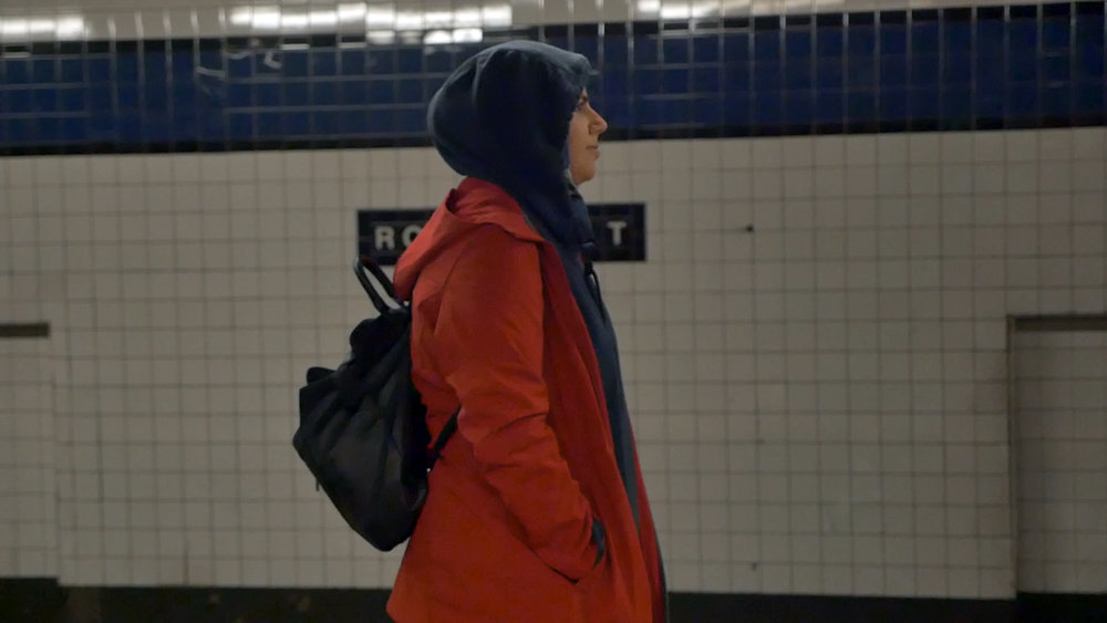 Badiaa, a radiology student, waits for the 5:14 a.m. train to her job at Dunkin Donuts.