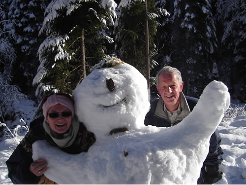 Professor Franz Mathis and his wife Christine with their snowy friend.