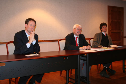 Andreas Riecken (left), charge d'affaires, welcomed Bischof and co-panelist Steven Beller (right) to the book presentation.