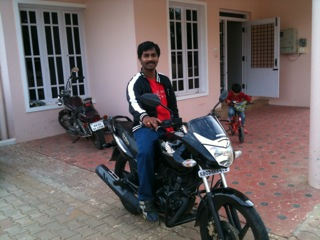 jayaraj on his bike in front of ravi's house