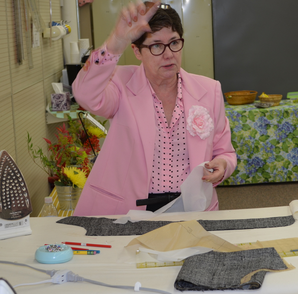Marta demonstrating how to press interfacing to fabric.