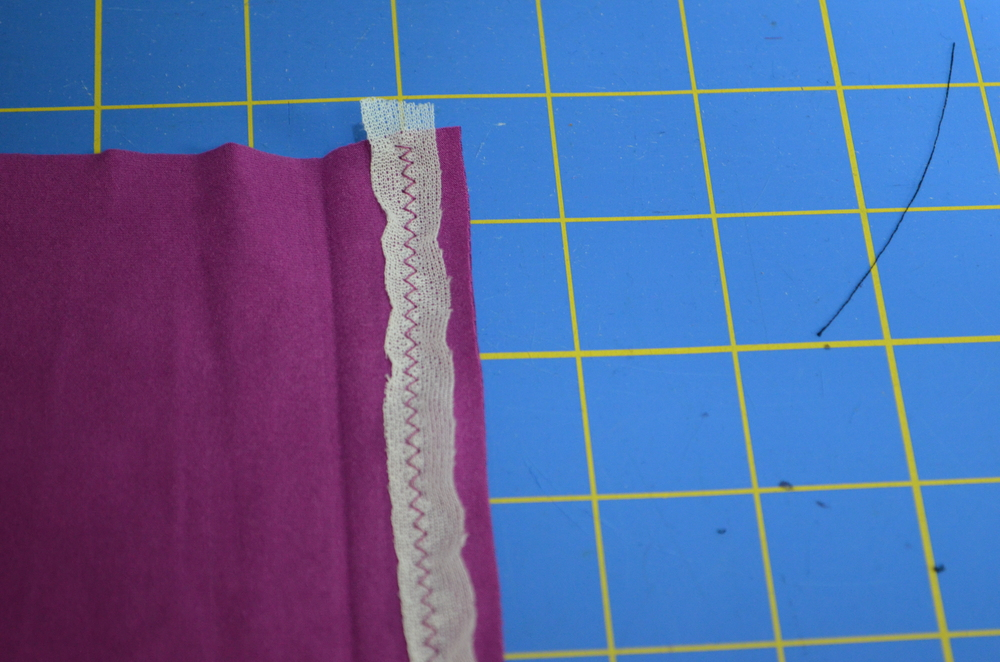 The hem of Angela Wolf's Ruched Tee with the knit stay tape zig zagged in place