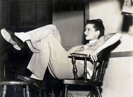Katharine lounging in the most classic of outfits. Image Source:(Photo by Haynes Archive/Popperfoto/Getty Images)