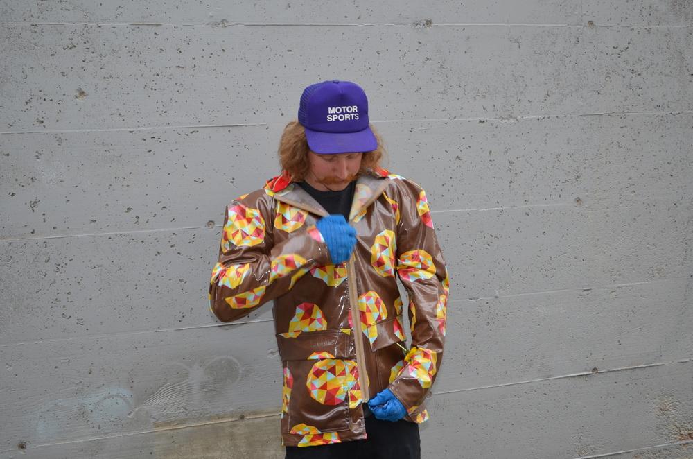 Boy raincoat in action.