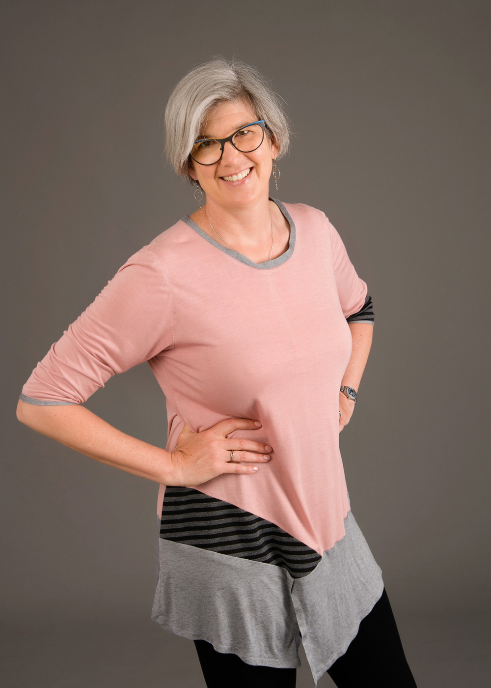 This top works great with a variety of knit weights. The black and gray stripe is a bamboo ponte, the pink is a mid-weight rayon knit, and the gray is a tissue-weight bamboo. Photo by Andrea Jones.