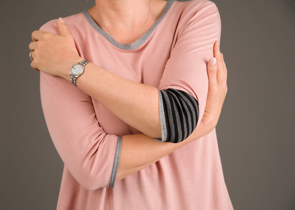 The left sleeve has a triangle insert at the elbow, adding even more interest to the top. Photo by Andrea Jones.